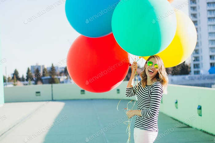 Millennial with colorful balloons