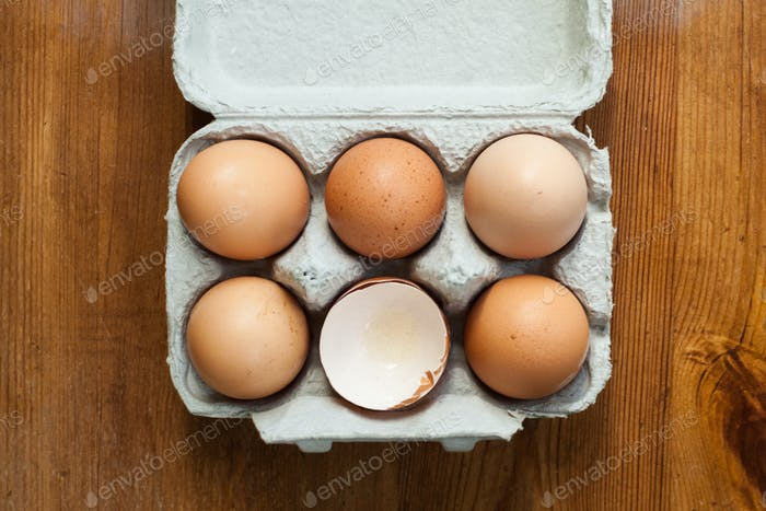 Brown eggs in a half dozen carton