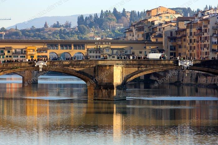 Ponte Vecchio over river, reflections in water