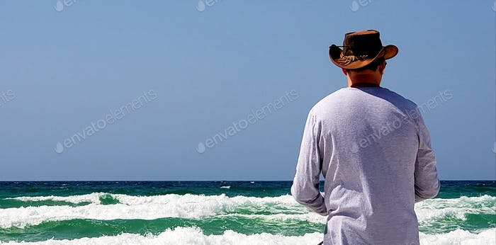 Hat man fishing for pompano in the ocean...