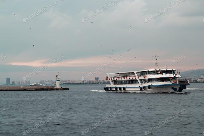Izmir Turkey 12 27 2019 White ferry boat in the Aegean sea in Turkey in cloudy dull weather