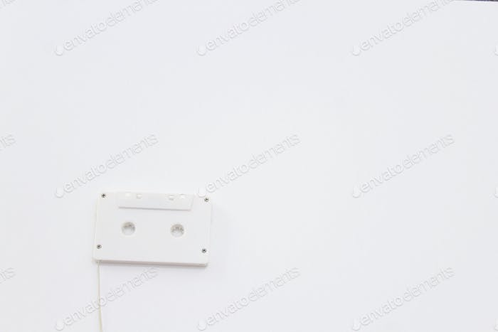 Old style tape recorder cassette white tape against white background