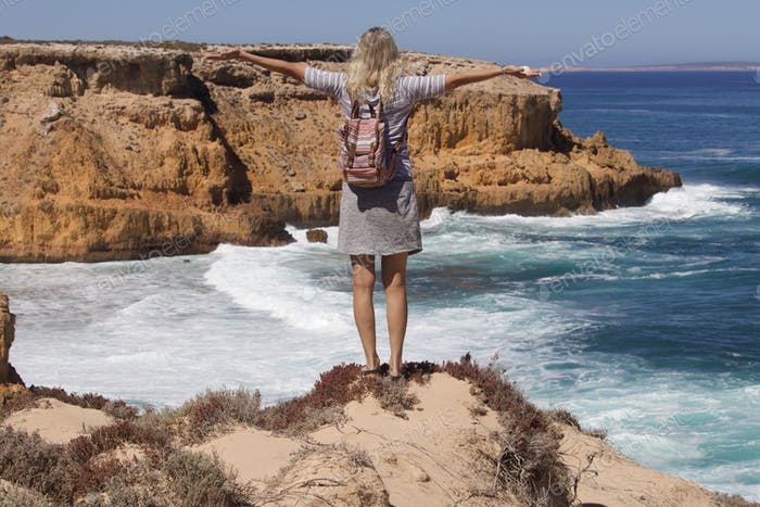 Woman from behind wearing backpack