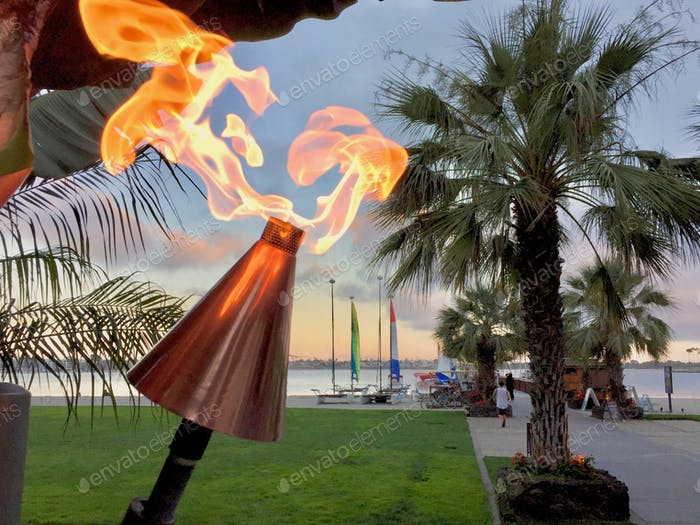 Dancing fire light at dusk on Mission Bay, San Diego California