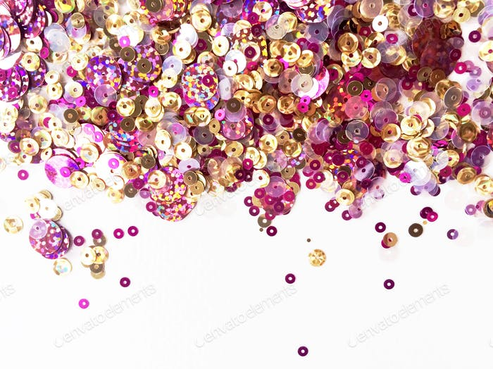 Landscape orientation of sparkling pink and gold glitter arranged across the top edge of a white