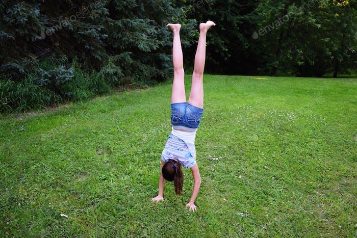 Girl doing handstands