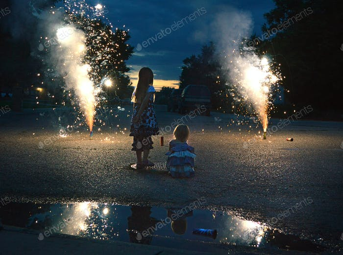 My daughter (right) and a neighbor girl watching street fireworks in Montana on July 4.