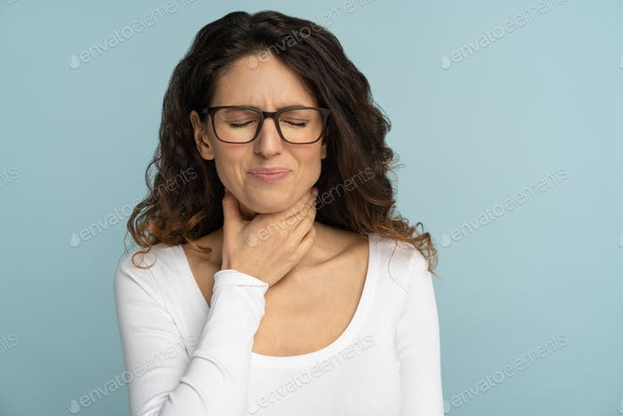 Sick woman having sore throat, tonsillitis, feeling sick, suffering from painful swallowing isolated
