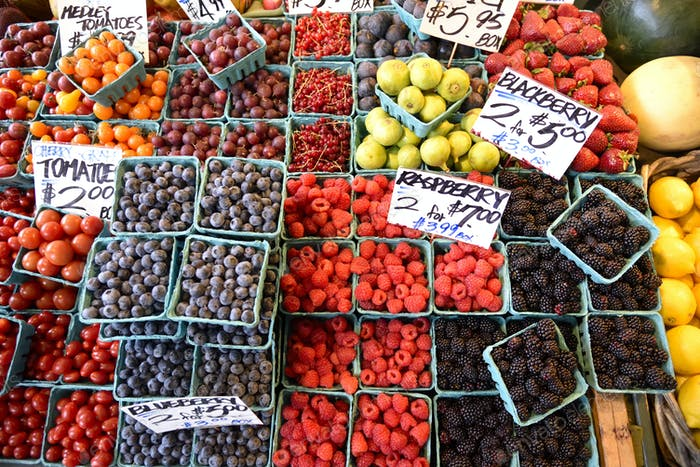 Assorted Berries at a farmers market in vibrant colors.
