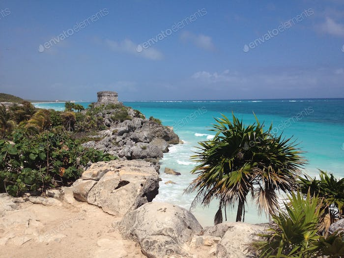 Mayan ruins overlooking the turquoise ocean in Tulum, Mexico