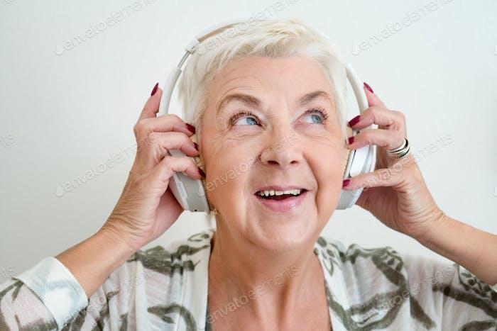 Senior adult listening to music