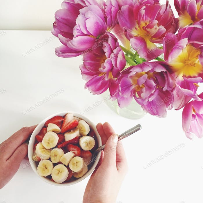 Fruity oatmeal bowls and over bloomed tulips