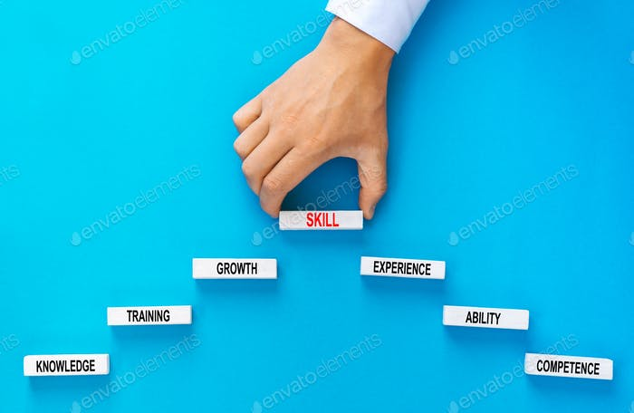 Skill concept. Businessman holding wooden blocks stacking as step stair with skill basic links  on y