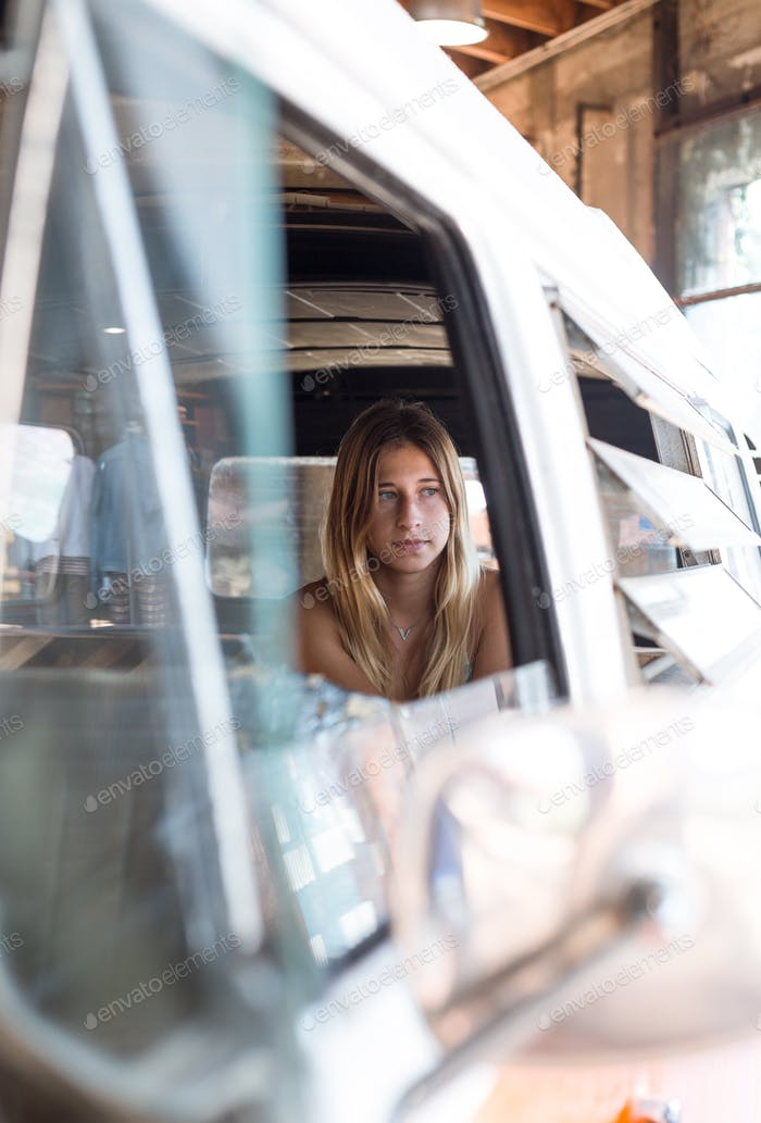 Girl in a van