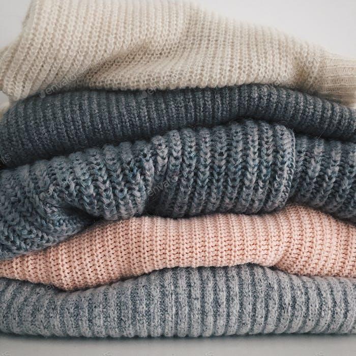 Stack of neatly folded woolen knitwear