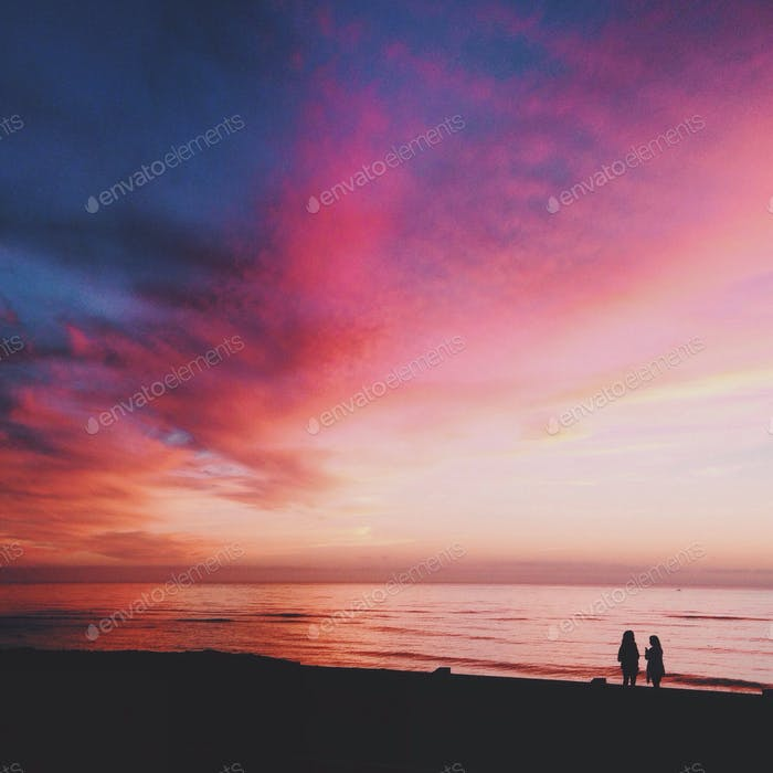 Pink clouds and silhouettes at Sunset Cliffs
