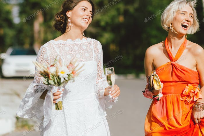 The happy bride and her best friend at the wedding party, bridesmaids
