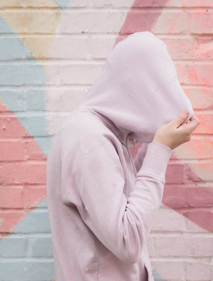 Shy Introverted Teen Pulling Hoodie Fully Over Her Head