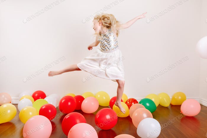 balloons; birthday; funny; girl; play; happy; celebration; home; alone; party; blonde; caucasian; ce