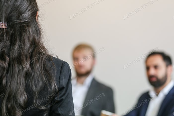 female co-worker giving a presentation in office at business