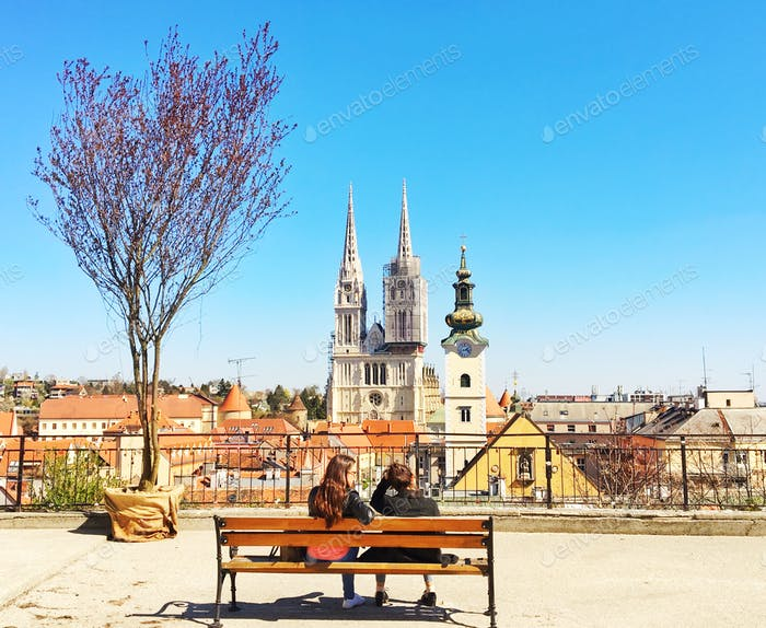 Two friends on a bench while visiting Croatian capital