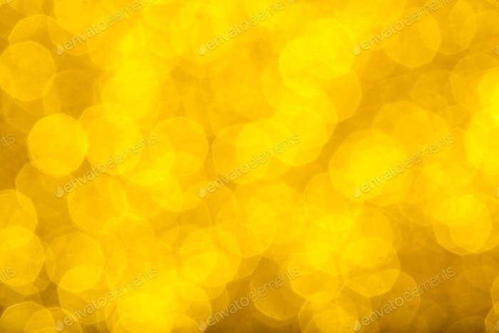 Fondo desenfocado con purpurina dorada para diseño, valor o abstracto de lujo
