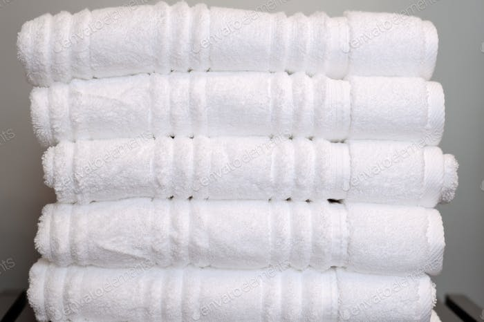 Stack of neatly folded white towels