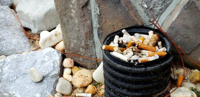 It's good for smokers to have outside ashtrays at restaurants but be nicer to empty them