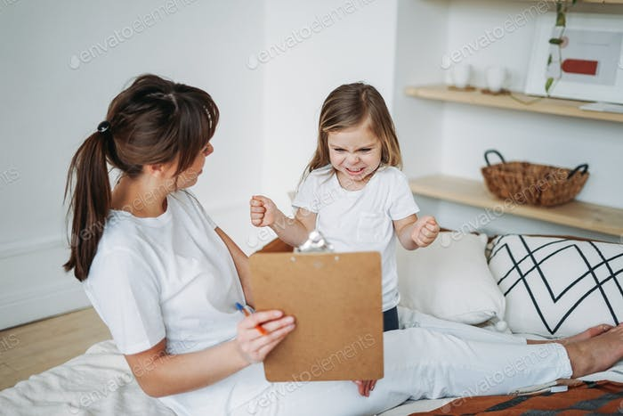Mother and daughter playing, girl is angry, she lives negative emotions. Children's psychological ed