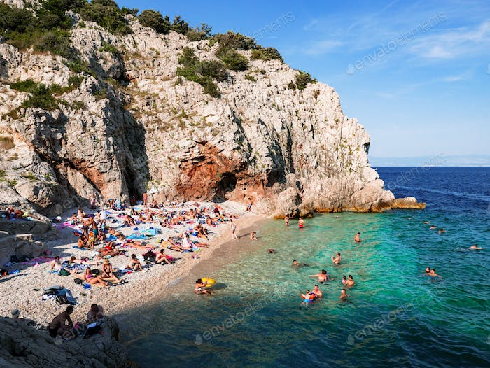 A hidden gem of a beach surrounded by rocks and cliffs