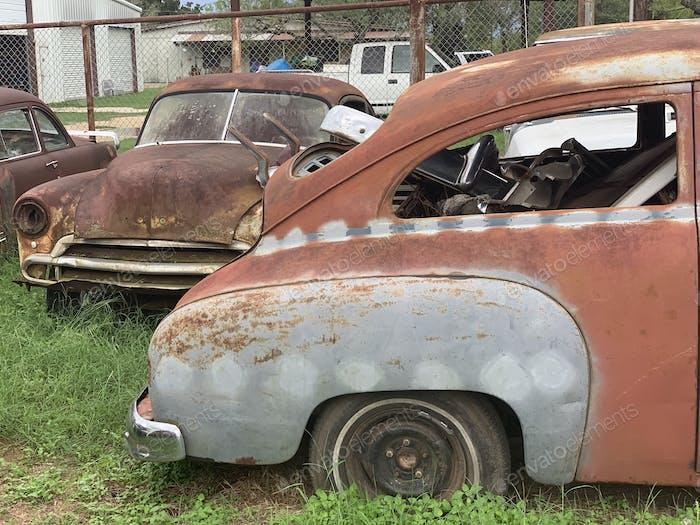 Vintage rustic car parts graveyard