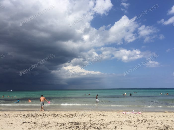 Gray skies to the left and blue skies to the right, Hollywood Beach, FL.
