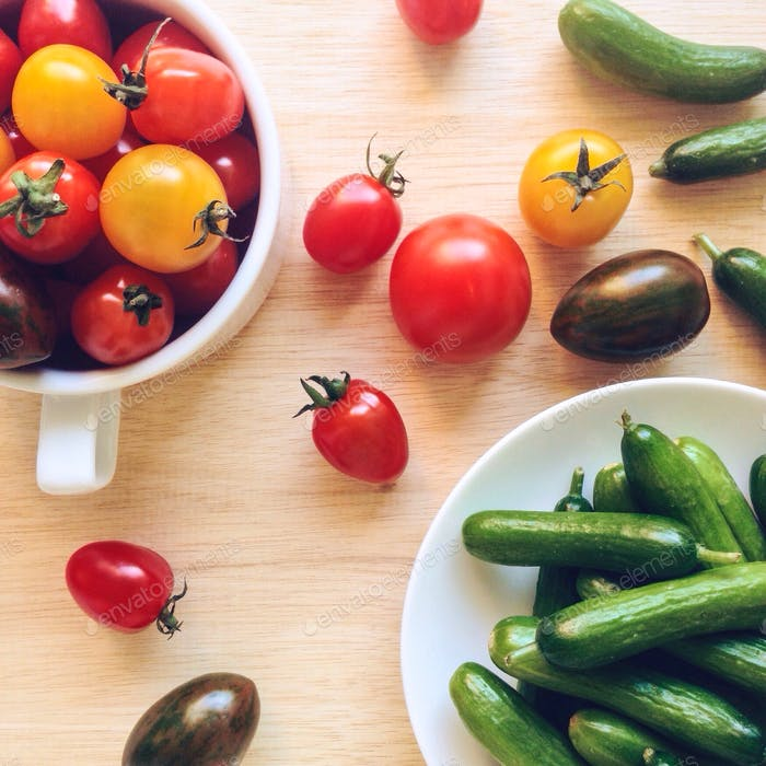 Healthy snacks with cherry tomatoes and Holland cucumbers