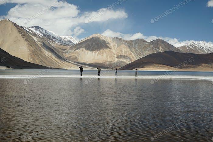 4 tiny humans posting at Pangong lake, Leh Ladakh, India