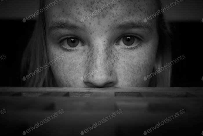 close up head shot of a girl with freckles