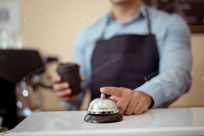 Baristas hand taking cup of hot coffee and bakery to offering to customer in coffee shop