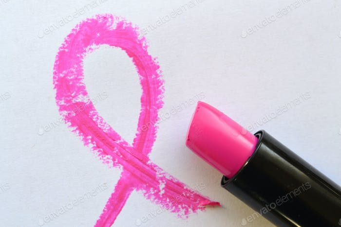 Pink remembrance awareness ribbon drawn in pink lipstick for breast cancer awareness month October