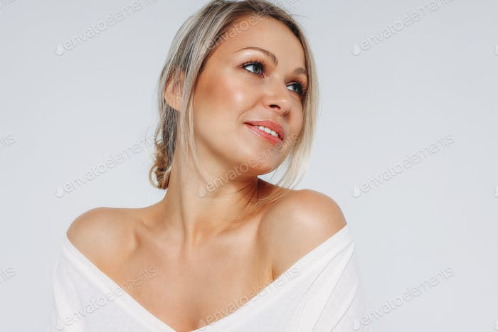 Blonde hair happy woman 35 year plus in white t-shirt isolated on the white background