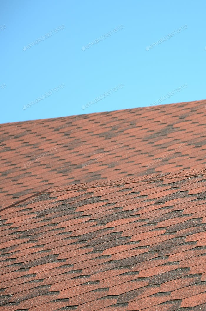 The roof is covered with bituminous shingles of brown color. Quality Roofing
