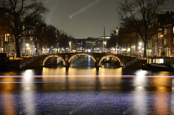 Amsterdam by night, view on the Amstel river