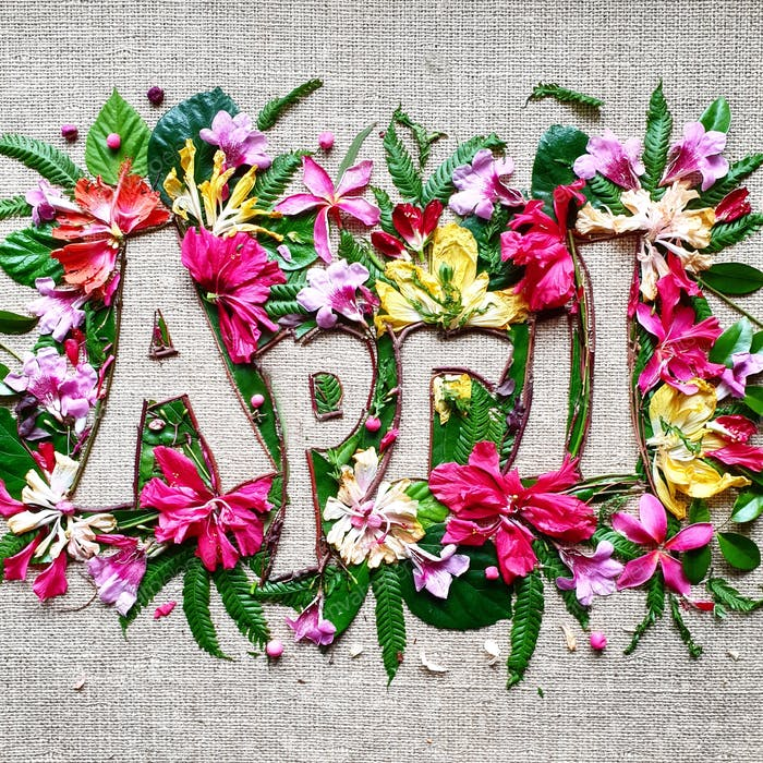 April,creative text made with colourful flowers