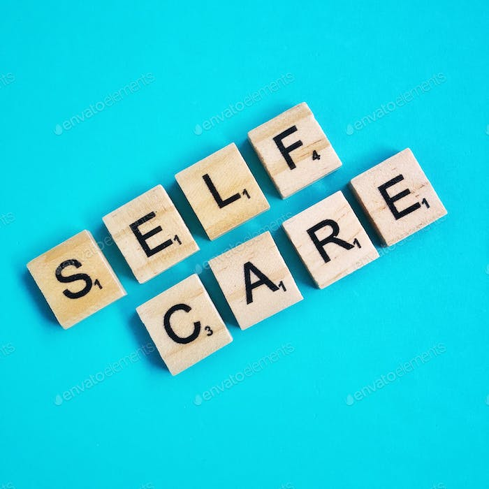 Self care letters on a bright blue bold background