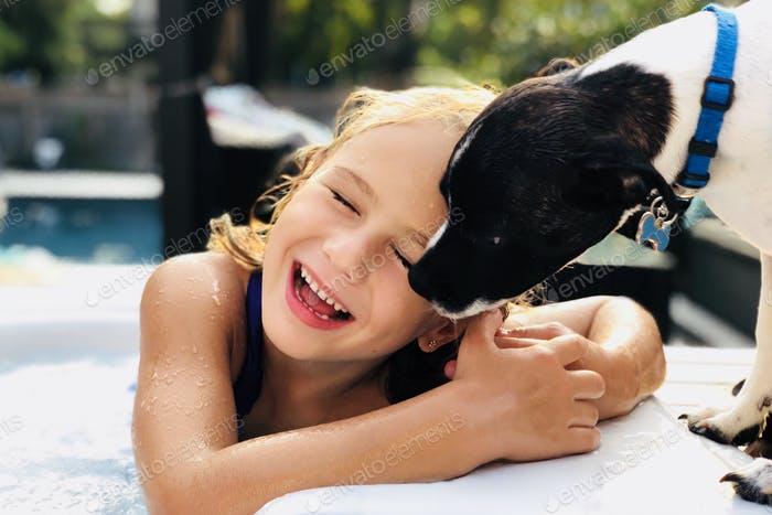 Happy Girl laughing ( doggie kisses )