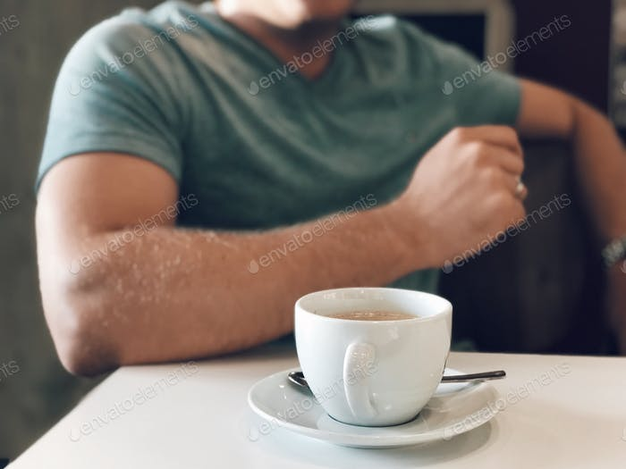 midsection, man, young adult, close up, at the cafe, drinking coffee, coffee cup