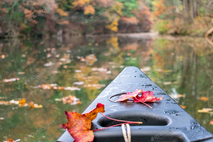 Canoeing in fall - outdoor recreation