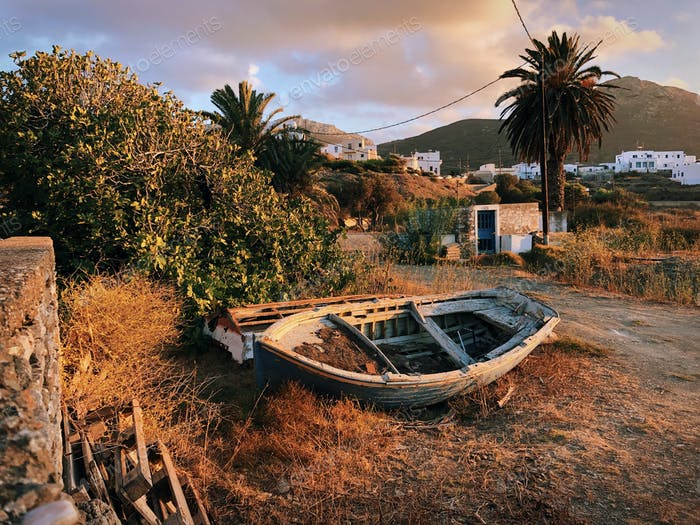 Natural tones earth tones of a wooden skiff stranded in a desert place in a Greek island...