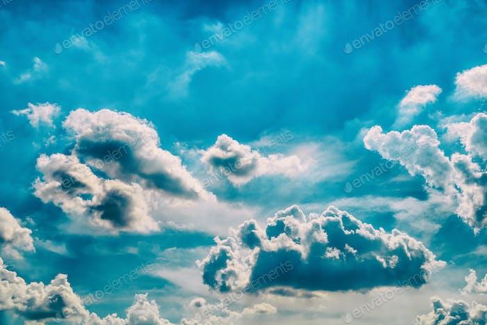 White Cumulus Clouds On Blue Sky