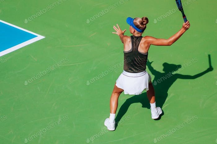 girl playing tennis, competitive sport, action shot, shadow