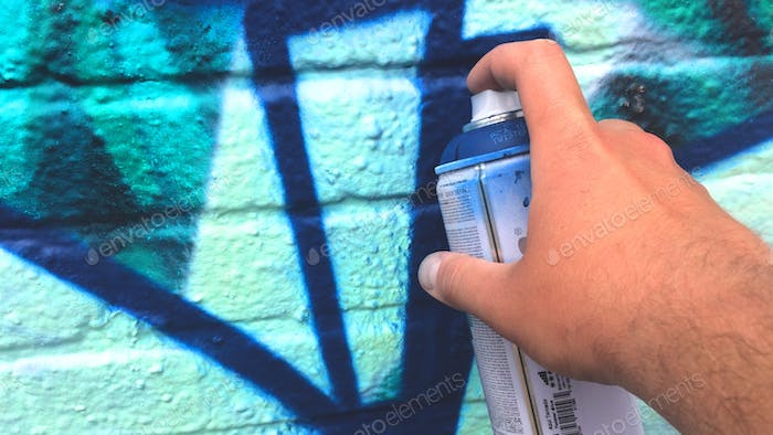 Spraying graffiti