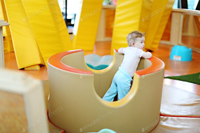 toddler in a toddler playground